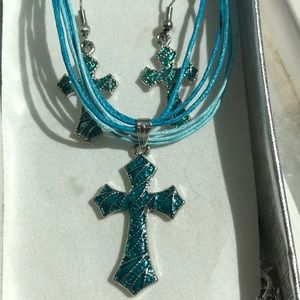 Teal cross necklace and earring set.
